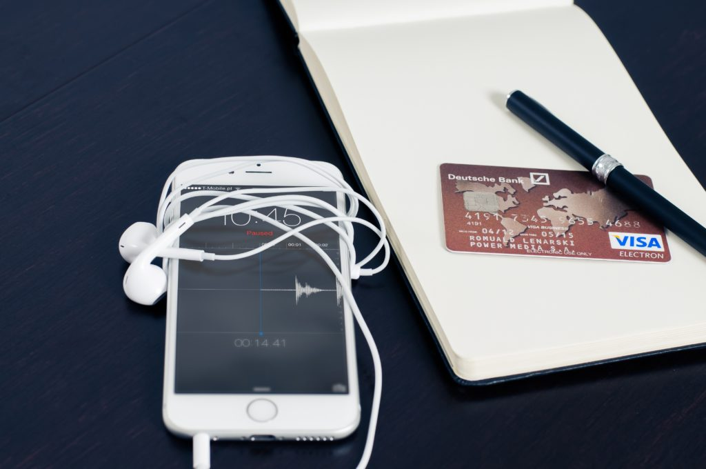 a picture of a cell phone and credit card