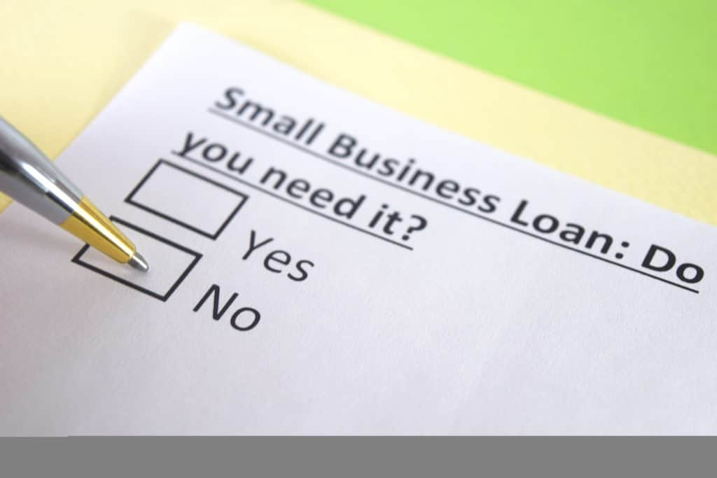 Business loan paper with yes or no check mark